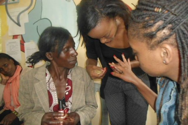 Pamela Gatwiri of Pam Nail Care Limited with customers.