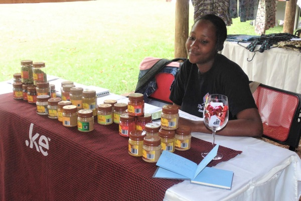 Sales Rep Sharon manning The Vine Eateries' table at WeCreate Market